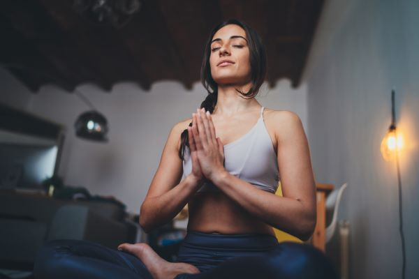 Woman meditating in the yoga pose, self-confidence for meditation